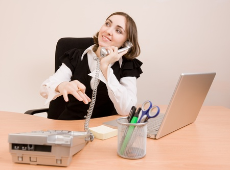 appointee: Businesswoman calling to phone at office