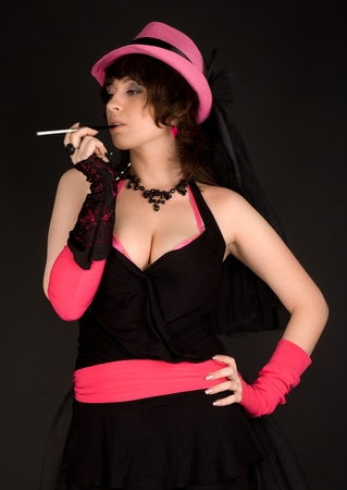 Sexy woman in pink with cigarette Stock Photo - 10743466