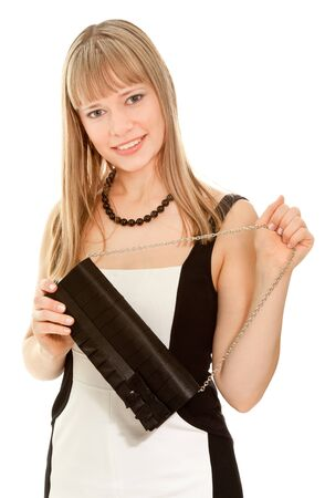 Beautiful businesswoman in dress and clutch smiling and looking to the camera Stock Photo - 10743544