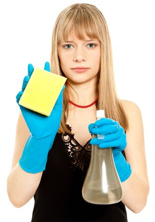 Beautiful woman holding sponge looking to the camera photo