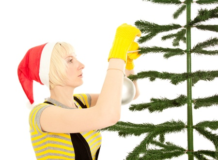 Woman in yellow gloves decorating fir isolated on white photo