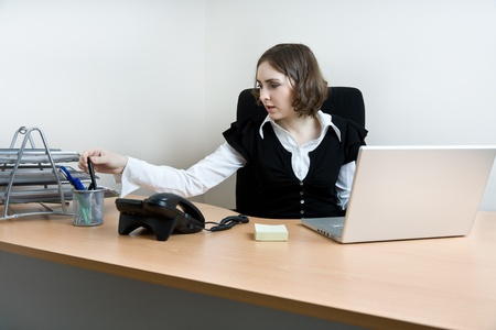 appointee: Young secretary with  telephone and laptop working