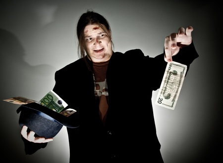 abomination: Man in black holding 20 dollars in abomination