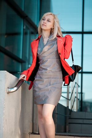 Beautiful woman in red jacket going to shops photo