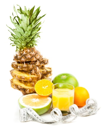 Picture of pineapple, oranges, green grapefruit and measure tape Stock Photo - 11844330