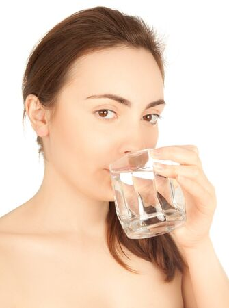 Beautiful nude woman drinking a water and looking to the camera photo