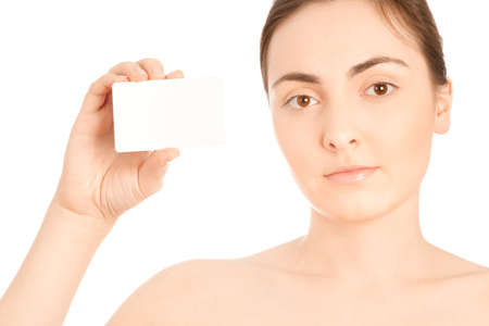 Beautiful woman holding a blank business card isolated on white photo
