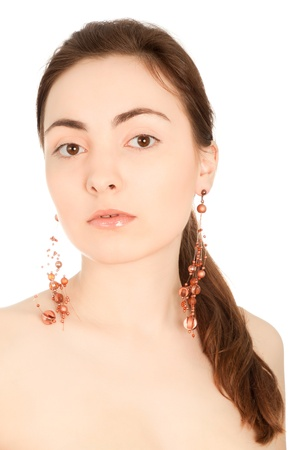 Portrait of beautiful woman with earrings isolated on white photo