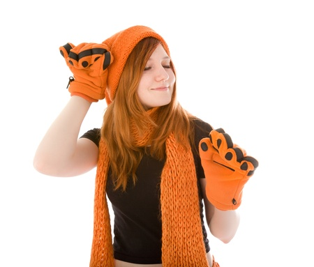 Red haired girl in orange hat, scarf photo