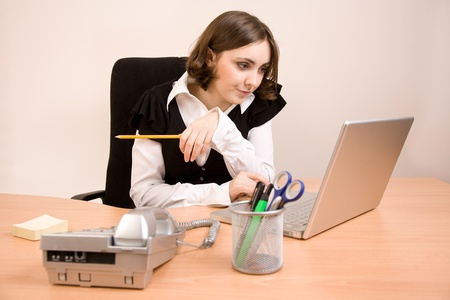 appointee: Young secretary with telephone, laptop and pencil working at office Stock Photo
