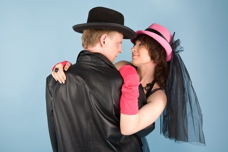 Woman in pink hat   and a man in black hat photo