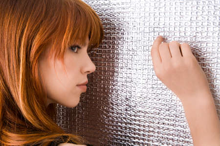 Beautiful ginger-haired woman standing on the wall Stock Photo - 12163343
