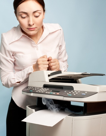 mfp: Picture of surprised businesswoman with smoking copier