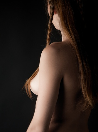 Beautiful blond naked girl on the black background Stock Photo - 12362038