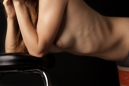Naked woman's body on the black background Stock Photo - 12362042
