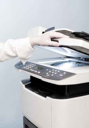 Woman's hand with working copier Stock Photo - 12895366