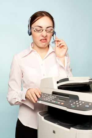mfp: Angry businesswoman with copier thinking on the  background Stock Photo