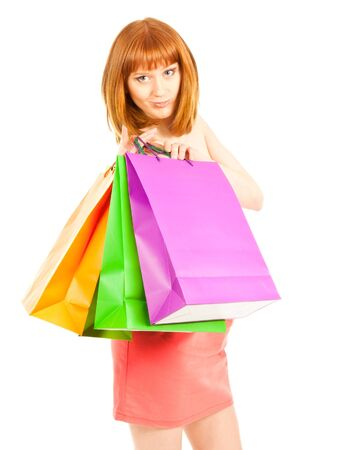 Beautiful young woman with her colorful shopping bags Stock Photo - 12837993