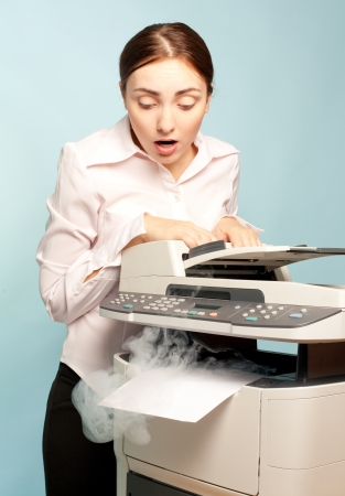 printer paper: Picture of surprised businesswoman with smoking copier