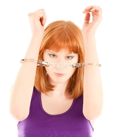 Woman with handcuffs isolated on white
