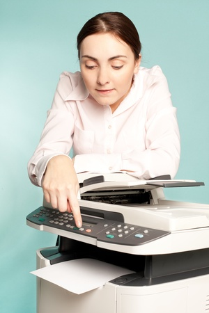 mfp: Businesswoman with copier preing on the button
