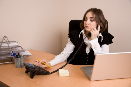 appointee: Businesswoman with telephone sitting at  the chair at office Stock Photo