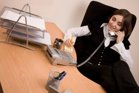 appointee: Businesswoman calling by phone at office