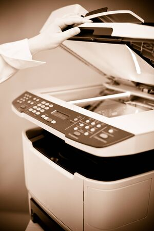 mfp: Womans hand with working copier