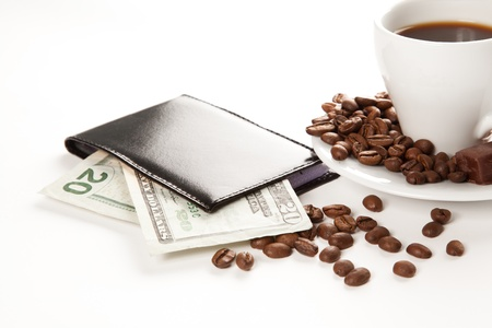 A cup of coffee,  seeds, candy and money photo