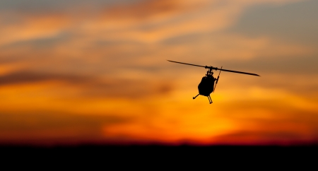 Picture of helicopter at sunset photo