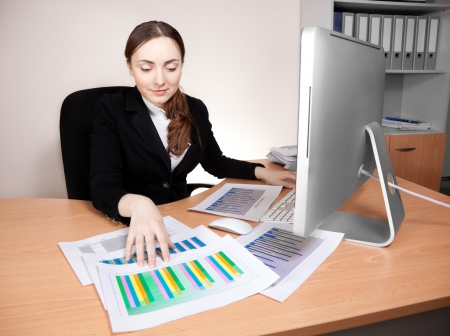 Businesswoman with financial report at office photo