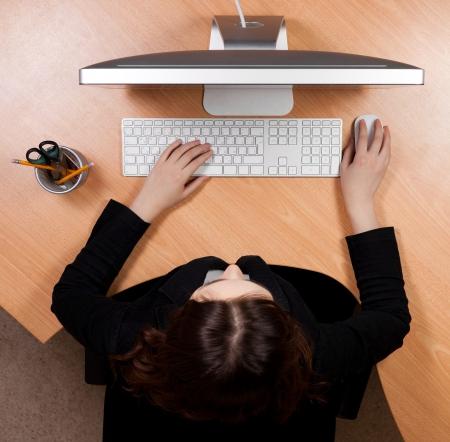 toetsenbord: Vrouw op het werk Stockfoto