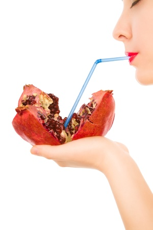 Beautiful woman with pomegranate and straw drinking photo