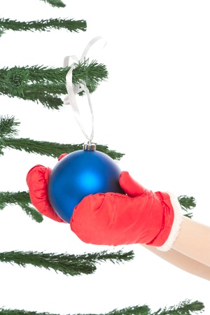 Woman s hands holding christmas toy isolated on white photo