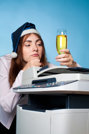 depressive: Depressive woman with party hat and a glas off champagne Stock Photo