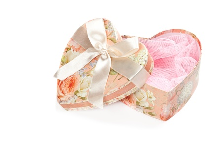 Pink heart shaped jewel box isolated on white photo