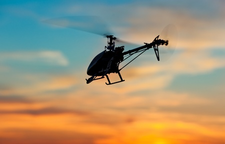 private plane: Picture of helicopter at sunset Stock Photo