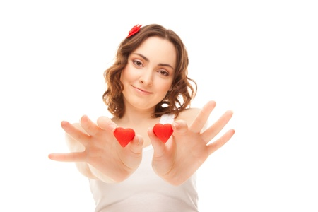 Young woman holding two red hearts  focus on hands  photo
