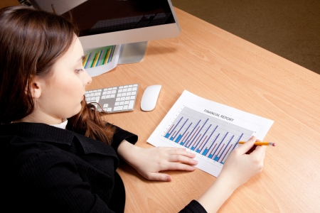 Businesswoman with financial report photo