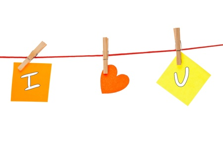 Colorful notes with inscription 'I love you' hanging on pins photo
