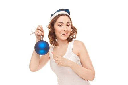 Beautiful woman in blue cap with christmas toy grimacing isolated on white photo