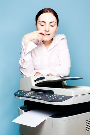mfp: Businesswoman with copier thinking on the blue background