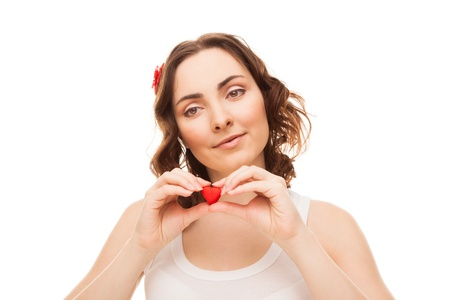 Young woman holding a heart shaped cookie isolated on white Stock Photo - 16881094