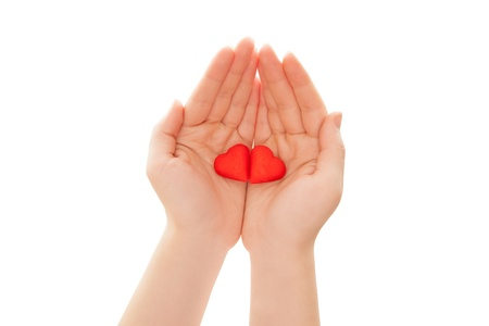 Woman s hands holding heart-shaped cookies isolated on white photo