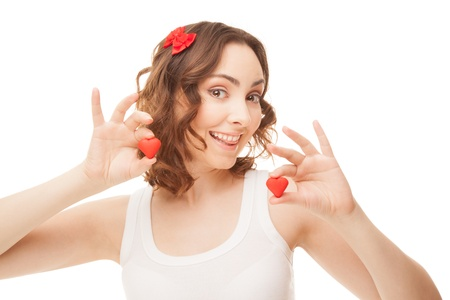 Cheerful woman holding heart-shaped cookies isolated on white Stock Photo - 16881085