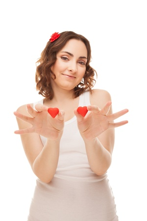 Woman holding heart-shaped cookies isolated on white  focus on cookies  Stock Photo - 16881122