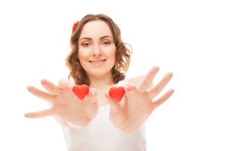 Woman holding heart-shaped cookies isolated on white  focus on cookies  photo
