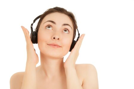 Naked woman in headphone  listening to music isolated on white Stock Photo - 16881118