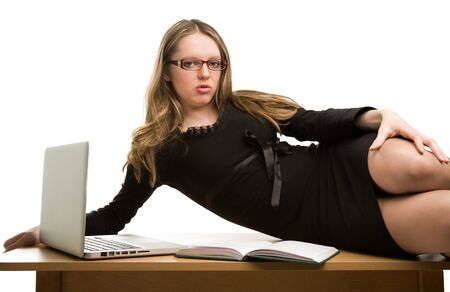 Sexy businesswoman lying on the desk isolated on white Stock Photo - 16881114