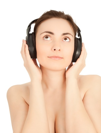 naked youth: Picture of girl listening to music in headphones isolated on white